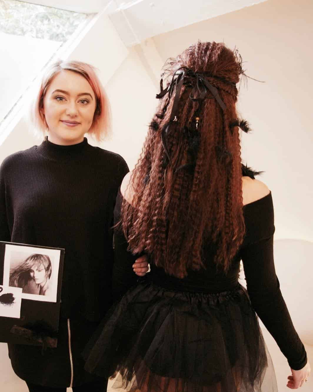 Millie (Stylist at Sadler Gate) with black swan themed model.